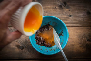 mixing chocolate and egg yolks in bowl